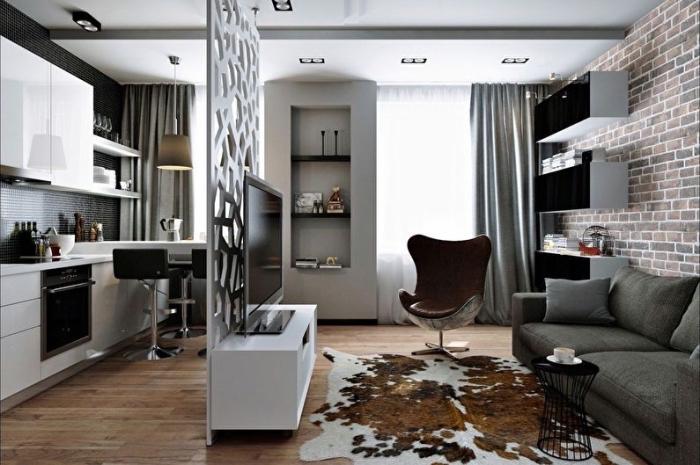 idée séparation espace dans studio en forme de meuble mur en blanc, déco de style moderne et industriel