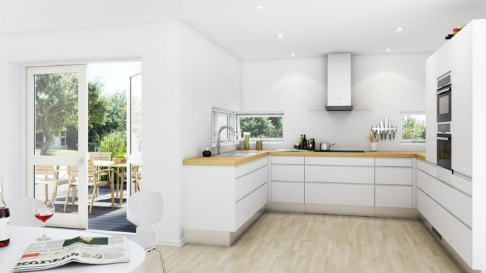 exemple de cuisine en U aménagée avec meubles design à ouverture automatique avec plan de travail de bois clair