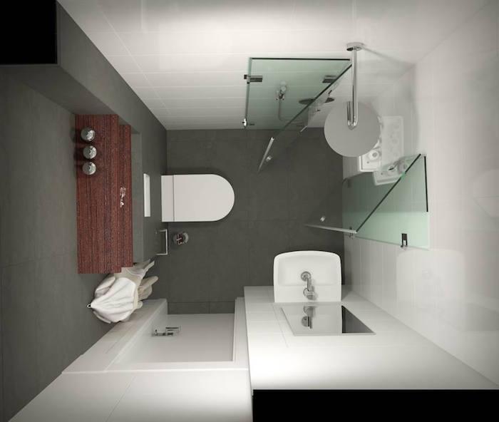 petite sdb carrée avec douche ouverte dans l'angle sur sol en carrelage gris anthracite