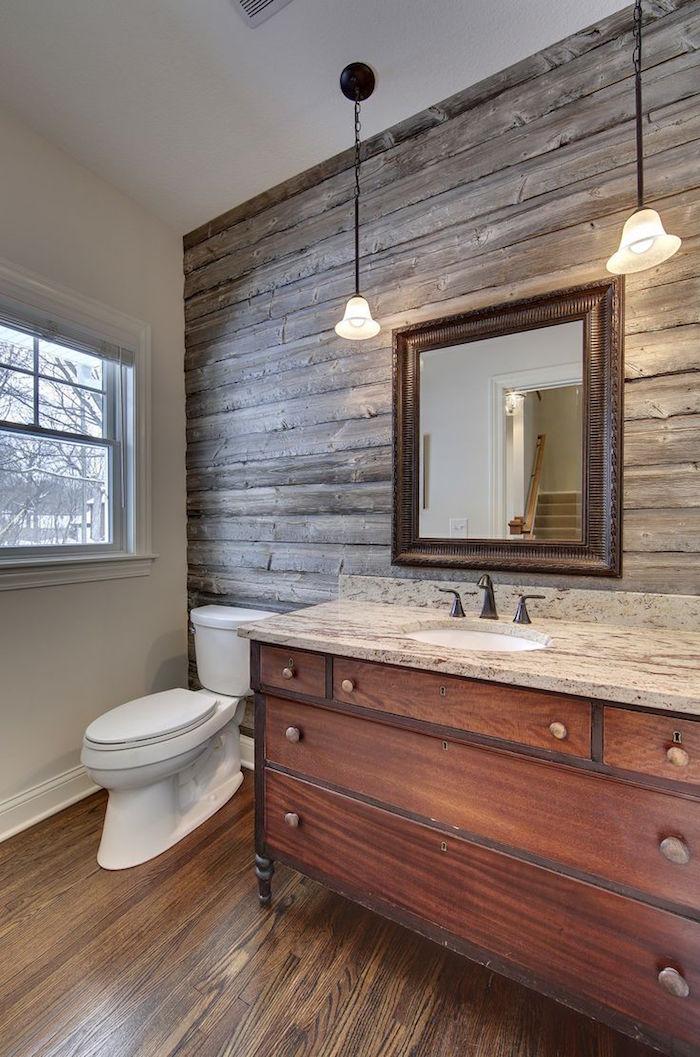 salle de bain rétro style rustique avec mur et meuble lavabo en bois et carrelage imitation parquet