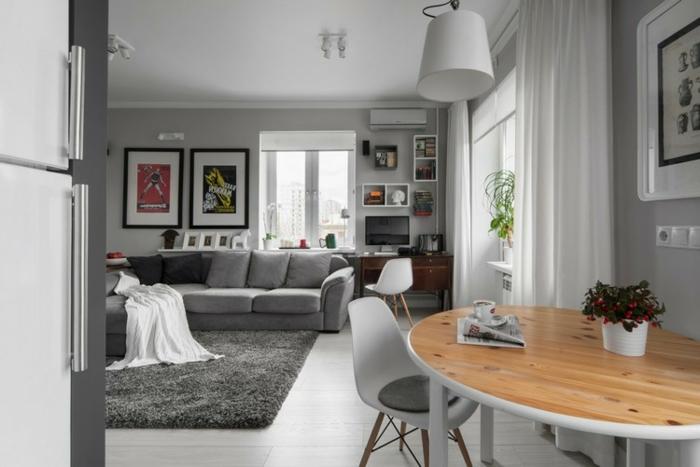 deco salle a manger gris et bois, tapis gris, table ovale bois et blanc, chaises scandinaves, peinture murale gris clair