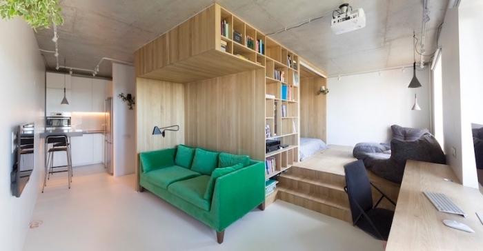 exemple de design intérieur moderne avec cube multifonctions en bois équipé d'espace lit et rangements bibliothéque