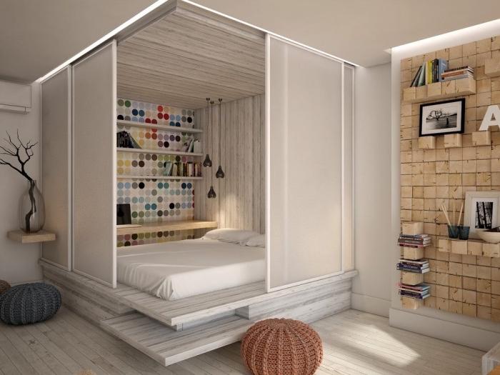 modèle de déco intérieure avec cube multifonctions avec fermeture portes coulissantes pour séparer le lit du salon dans un studio