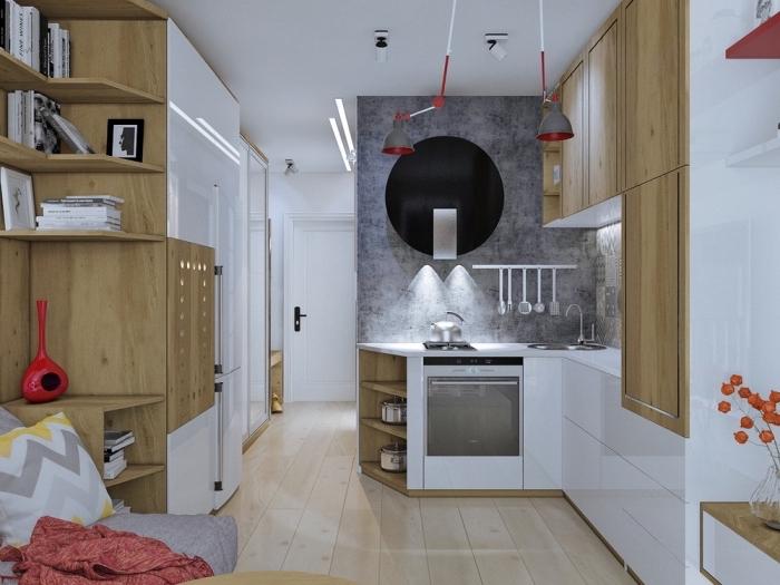 intérieur moderne en blanc et beige avec pan de mur à design béton gris et accessoires de nuances rouge vibrants
