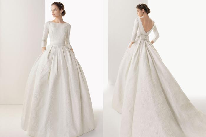 robe de mariée hiver princesse avec une longue traine coupe princesse et top avec des manches longues