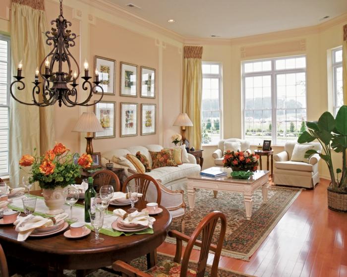 deco salle a manger, table ronde, chandelier rustique, tapis persan, peinture pêche, grande plante verte