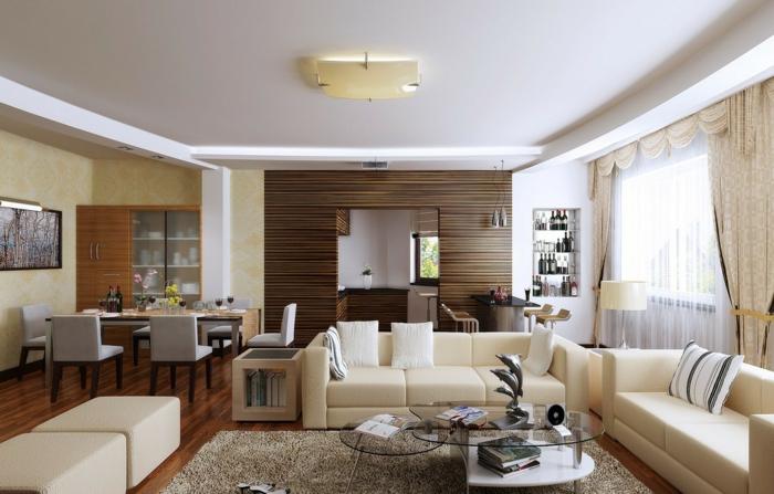 salle de séjour tendance, tapis taupe, tabourets et canapés couleur crème, tables basses en verre, studio bien équipé
