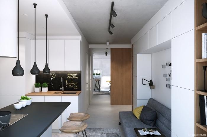 intérieur moderne dans un petit studio avec petite cuisine en blanc et bois, modèle d'éclairage industriel à finition noir