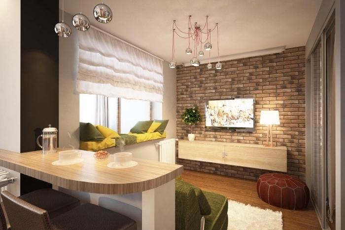 déco de style moderne et industriel dans un studio avec pan de mur en papier peint design briques et meubles de bois