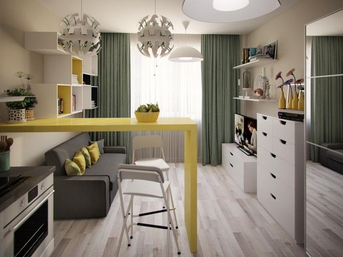 intégrer des couleurs vibrantes dans la déco monotone, studio moderne avec petite cuisine équipée d'un ilot central jaune