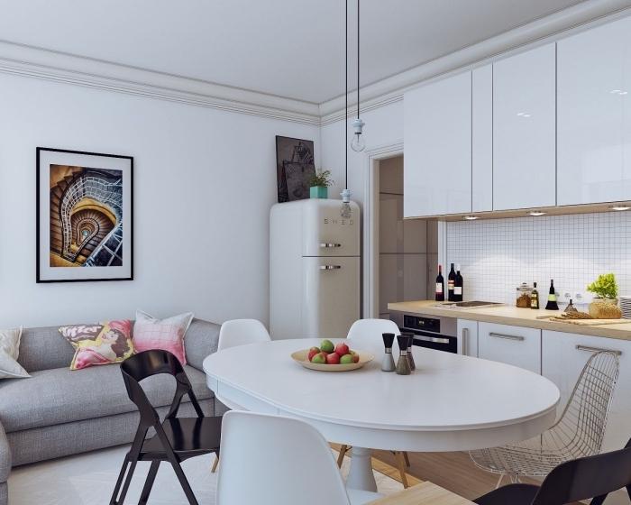 aménager un petit appartement avec meubles de couleurs claires, déco de cuisine blanche laquée avec meubles sans poignées
