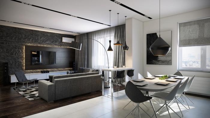 comment associer les couleurs neutres dans un intérieur moderne avec mur gris en pierre et éclairage neon sous meuble tv