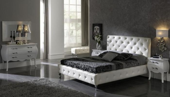 ambiance relaxante et zen dans une chambre à coucher pour femme aux murs gris et plancher laqué avec meubles blancs