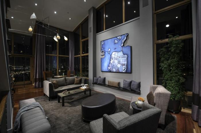 un salon en gris anthracite, tapis gris, canapés gris, tables basse noires, verrières design