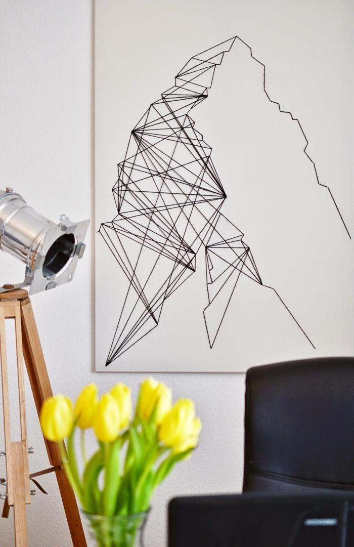 exemple d'activité manuelle facile pour faire une déco d'intérieur stylée, modèle de panneau blanc et noir en fil