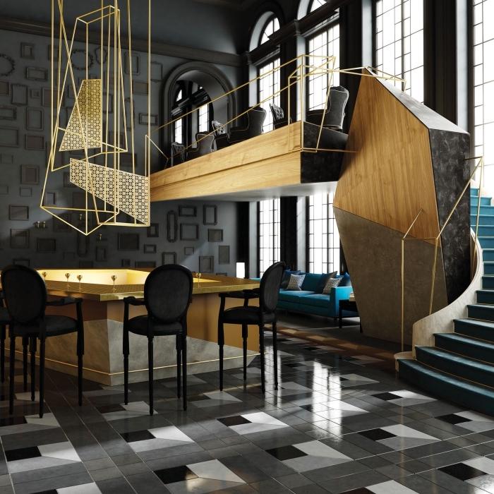 déco d'intérieur moderne dans un appartement loft aux grandes fenêtres et plafond haut, l'or comme une couleur qui se marie avec le gris