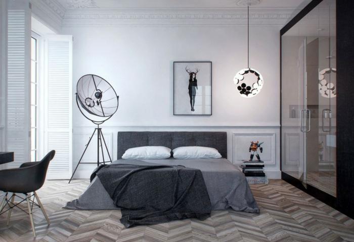 sol en chevron dans une chambre adulte moderne, peinture extravagante, armoire moderne, petit bureau flottant