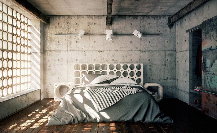 parquet bois marron, linge de lit gris et blanc, murs en béton, poutres métalliques apparentes, sol en bois, tete de lit originale à trous