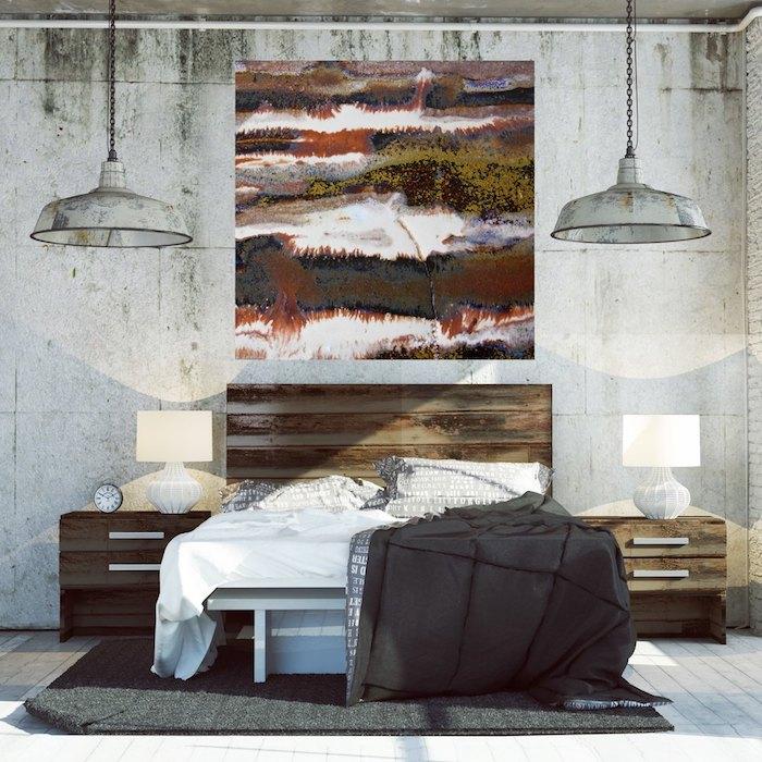 exemple d aménagement d un loft industriel en murs effet béton, cadre peinture original, suspensions industrielles, parquet blanc décoré d un tapis gris foncé