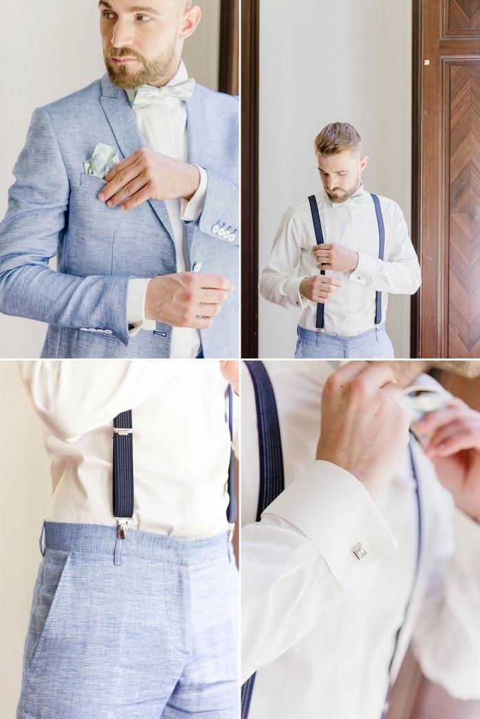 une tenue homme mariage d'été aux tons pastel, costume de marié bleu clair en lin accessoirisé avec bretelles et un noeud papillon vert d'eau