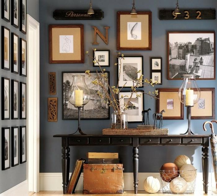 console simple design vintage, mur bleu colombe, plusieurs photos encadrées