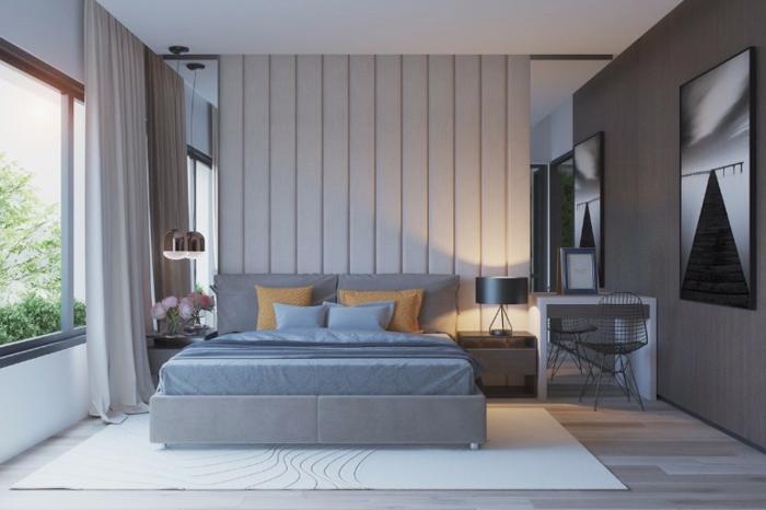 chambre à coucher cosy en gris et blanc, tapis blanc, sol boisé, peintures originales