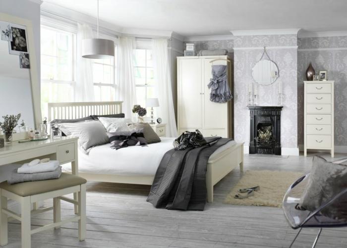 deco chambre blanche, papier peint géométrique, miroir rond accroché, armoire blanche, bureau blanc, sol en planches de bois