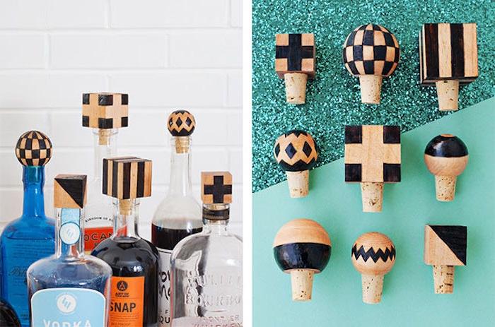 bouchons de liège décorés à motifs noirs sur de bouteilles alcool en verre, idée de cadeau pour la fête des pères