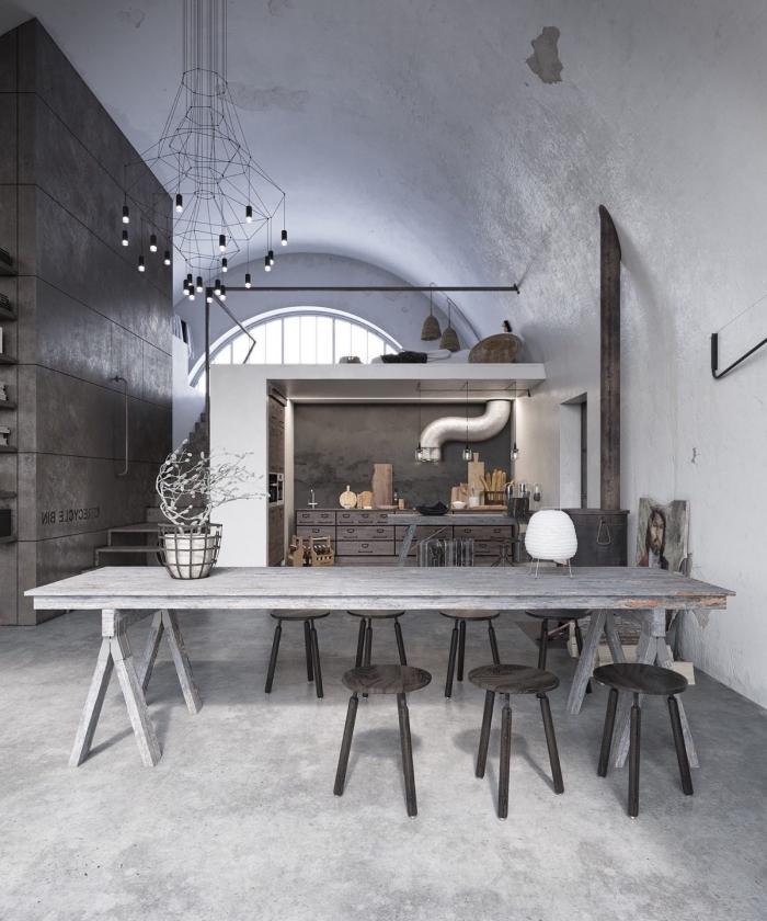 aménagement de style loft industriel avec un mur gris foncé et haut plafond, éclairage industriel avec lampadaire suspendu