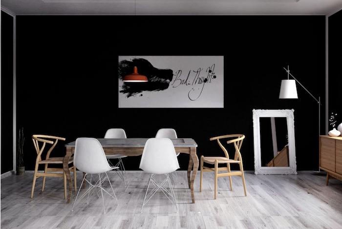 salle a manger contemporaine style scandinave avec murs noirs et meubles design en bois style rustique