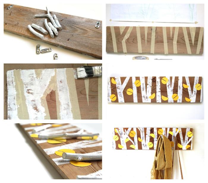 idée comment fabriquer un porte manteau scandinave original en planche de bois avec motif arbre dessiné, feuilles de papier jaune et brindilles pour accrocher un manteau et autres accessoires