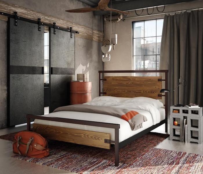 rideaux gris industriels, murs à effet béton, lit bois et métal comme meuble industriel, table de nuit en béton, porte galandage industrielle
