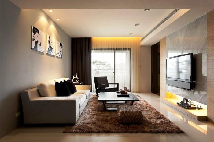 amenagement salon simple et beau, sofa beige, table basse noire, tapis marron moelleux, murs couleur taupe
