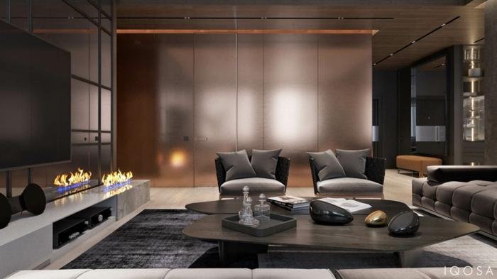 cheminée ouverte, chaises grises, table en bois, sofa gris, panneaux muraux