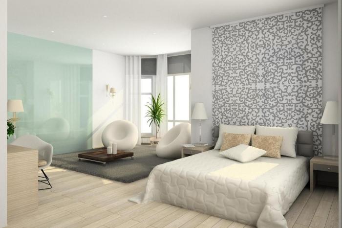 idées déco tête de lit avec du papier peint graphique posé sur un pan de mur derrière le lit pour réveiller la déco unie de cette chambre à coucher beige