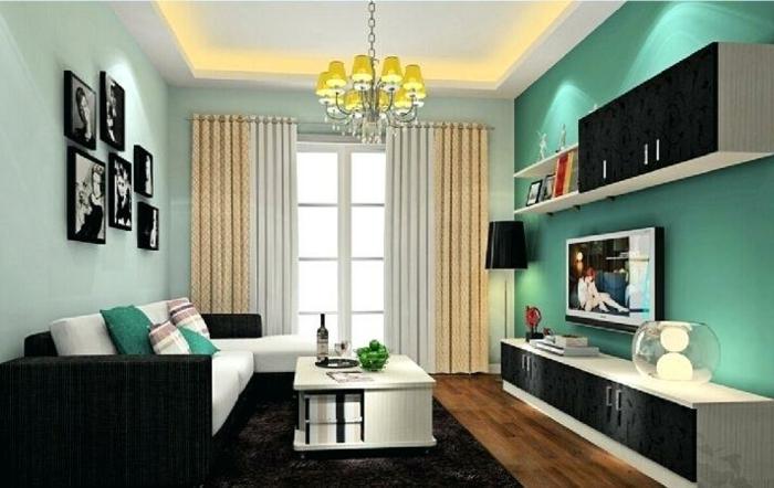 peinture murale vert menthe, étagère blanche, plafonnier baroque, cadres photos, meuble de tv bas