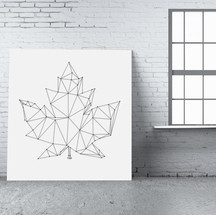 modèle de tableau fil tendu de style minimaliste sur une planche de bois ou carton peint en blanc avec création en forme de feuille