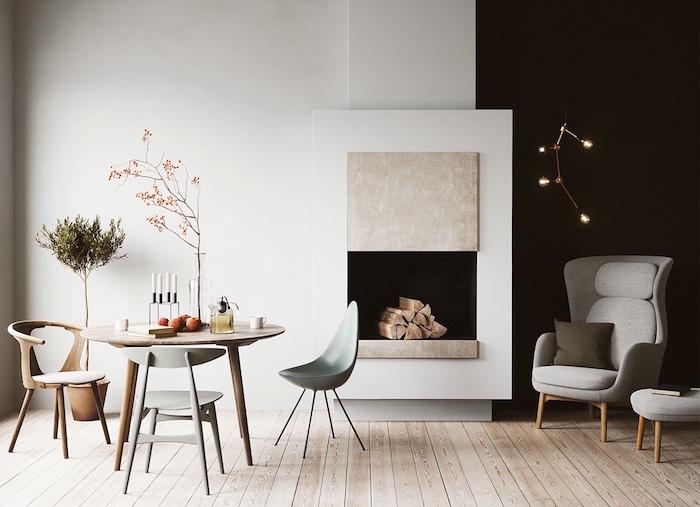 meuble de salle à manger design scandinave avec meubles en bois et plastique originaux fauteuils en tissu rétro et mur blanc et noir