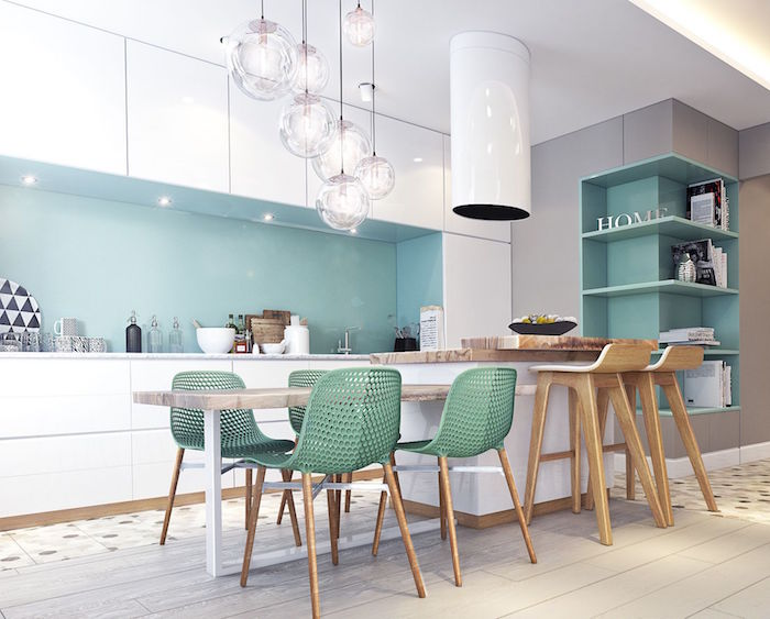 salle à manger moderne avec cuisine ouverte blanc et vert design et chaises en bois contemporaines