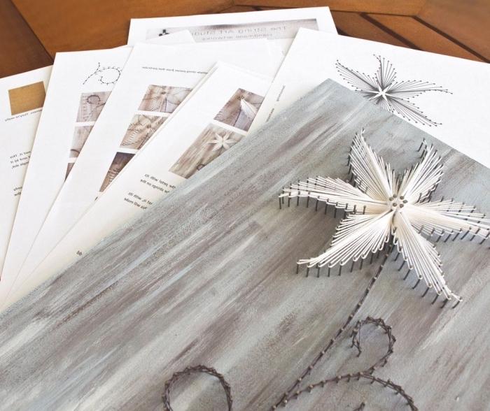 essayer une activité manuelle facile avec un kit de création fil à coudre en forme de fleurs sur une planche de bois