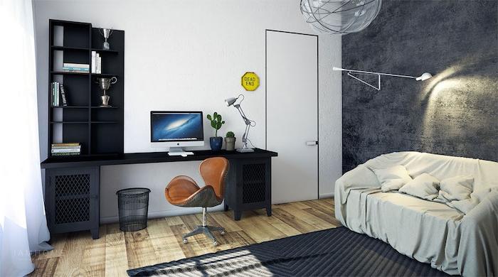 exemple de bureau style industriel en noir, mur gris anthracite, canapé gris, parquet clair, tapis gris foncé, chaise en cuir industrielle