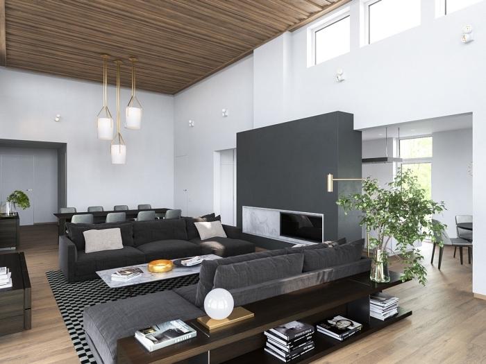 aménagement de salon aux murs blancs avec plafond et plancher de bois, modèle lampadaire blanc et or de style industriel
