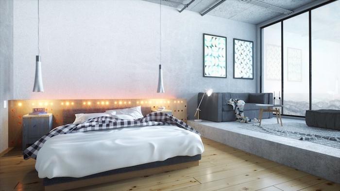 idée de tête de lit en bois et lit bois avec linge de lit noir et blanc, parquet clair, lumières intégrées, estrade salon gris dans un studio loft industriel