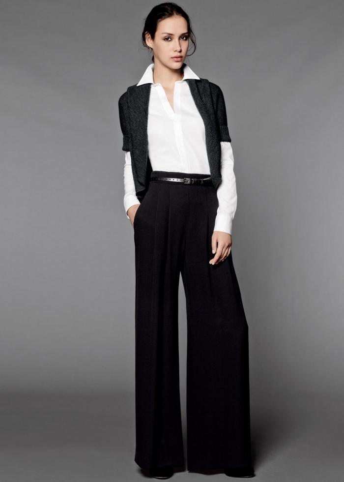 look formel en pantalon noir fluide et ceinturé porté avec chemise blanche et gilet gris foncé aux manches courtes