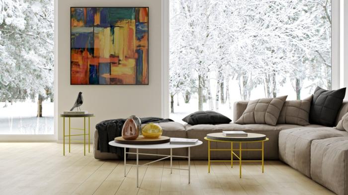 idee deco mir salon, papier peint trompe l'oeil, tables basses rondes, cadre peinture en couleurs vives, sofa gris d'angle