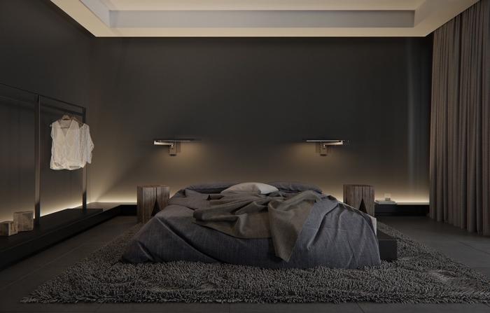 ambiance sereine dans une chambre adulte aux murs foncés et plafond suspendu blanc avec éclairage doux
