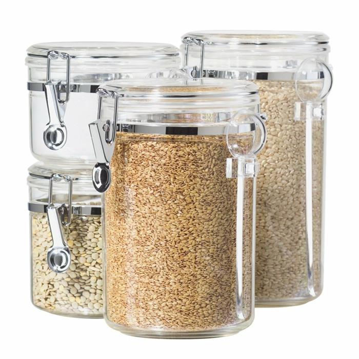 des bocaux pour le rangement placard cuisine, verre transparent avec des couvercles en plastique blanche, conteneurs pour céréales et épices, tiroirs de rangement, amenagement placard cuisine