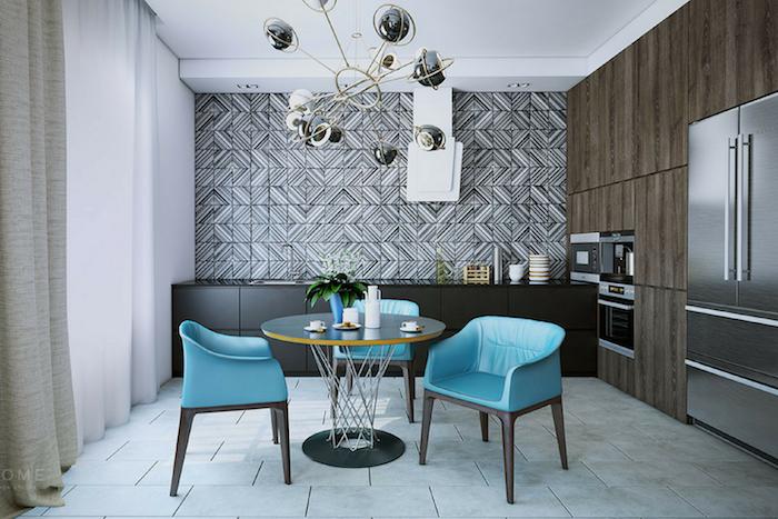 meubles de salle à manger design avec fauteuils en cuir bleus et table ronde et lustre designer