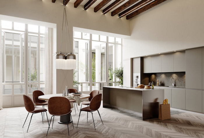 salle à manger complète design avec cuisine ouverte et ilot gris sur parquet avec chaises rétro et murs blancs