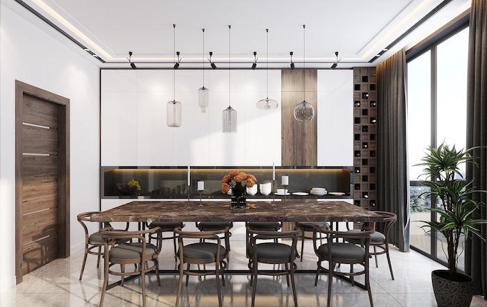 ensemble cuisine salle à manger blanc et marron avec table type marbre et lanternes suspendues